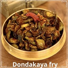 INGREDIENTS Dondakayalu - kg Onions - 2 medium size chopped Green chillies - 3 (slit) Turmeric powder - 1 tsp Red chilli powder - 1 tsp Salt to taste TALIMPU Oil - 4 tbsp Urad dal - 1 tsp Cumin seeds - 1 tsp Broken red chilli pieces - 4 Garlic -… Light Golden Brown, Red Chilli, Curry Leaves, Turmeric, Cooking Time, Delicious Food, Fries, Beef, Red Chili