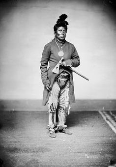Portrait (Profile) of Te-Low-A-Lut-La-Sha (Sky Chief) - Pawnee in Partial Native Dress with Peace Medal and Ornaments and Holding Pipe - Tomahawk 1868, by William Henry Jackson (1843-1942)