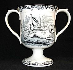 Loving Cup, 6 inches high by 4.5 inches in diameter and 7 inches from handle to handle.  It is printed with a large running pointer on one side and a hunting scene complete with dogs, hunters, and horses on the other side. Condition is excellent.  The loving cup was probably made between 1840-1850, possibly in Staffordshire. The Other Side, Hunters, 6 Inches, Cup And Saucer, Objects, Porcelain, British, Scene, Handle