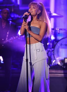 See How Ariana Grande Works Huge Pants with a Tiny Top from InStyle.com