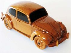 The classic VW Bug is wonderfully replicated in this solid mahogany scale model. Movable wheels, finely detailed molding and seam details, make this model a great gift or conversation piece. Finished with multiple coats of durable polyurethane for high gloss and deep wood grain.