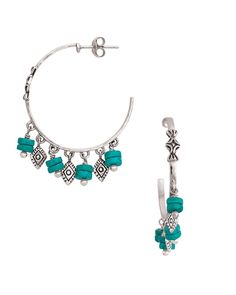 You're sure to get compliments on these hoops that make a statement! Boasting alternating drops of turquoise-hued beads and diamond-shaped Sterling Silver details. Go for a Southwest look by coordinating the Dive In Earrings with cool neutrals, like creams and tans, or add them to yellows and corals for a fun, summery feel. Shop them here: https://mysilpada.com/shop/product/dive-in-earrings-P3262