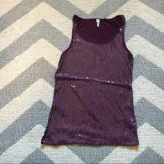 Plum sequined tank top Worn and loved ... There are spots where some sequins are missing (pictured) not noticeable from a distance Maurices Tops Tank Tops