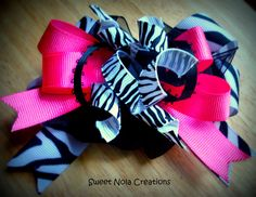 $9.00  Zebra Stripped and Hot Pink Boutique Bow  By: Sweet Nola Creations