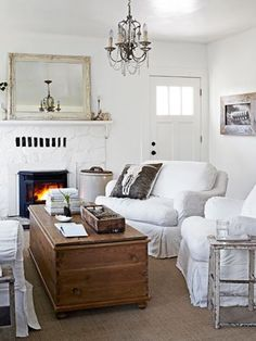 Single-Hued Simplicity  A Pottery Barn sofa and custom chairs flank a pine trunk in the living room of this Northern California home. The owner shot the feather photo that hangs on one wall, as well as the skull image that adorns a pillow from her company, Archival Decor.  Read more: Cozy Living Room Ideas - Decorating Ideas for Cozy Living Rooms Follow us: @Elizabeth Lockhart Lockhart Lockhart Cassinos Living Magazine on Twitter | CountryLiving on Facebook Visit us at CountryLiving.com by…
