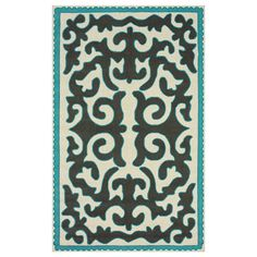 Eye-catching scrolls adorn this hand-hooked wool rug, offering chic style for your floors.   Product: RugConstructio...