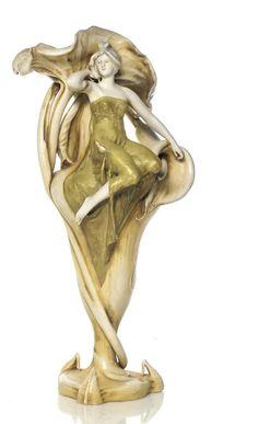 AMPHORA: RIESSNER STELLMACHER & KESSEL - 'CALLA LILY' A LARGE PORCELAIN FIGURAL VASE, C1905