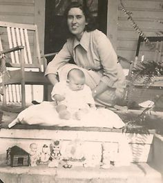 Aunt Clyde holding Linda on Granny's front porch, Christmas in 1949.