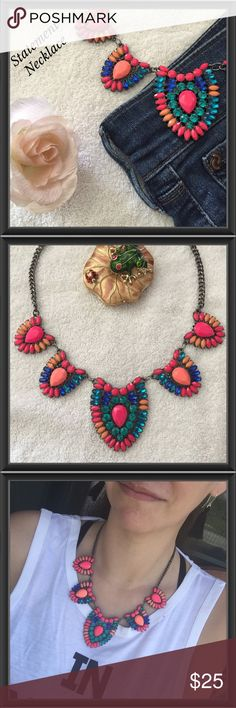 Statement Necklace Gorgeous statement necklace with a gunmetal colored chain. This piece pops with bright pinks, peaches, teals & blues! Use this necklace with neutrals to add contrast or with matching colors to accentuate your outfit. Adjustable from 19 Inches to 22 Inches. New Without Tags.  Boutique Jewelry Necklaces