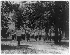 Girls from Washington, D.C., at Y.W.C.A. camp near Winona, Maryland, doing outdoor exercises, 1920s