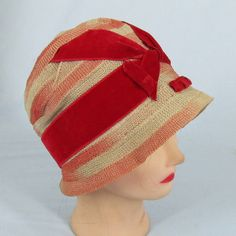 Straw cloche with red velvet decoration