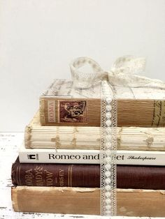 Show your love of literature with beautiful book centrepieces. Collect old classics from charity shops and bundle them together with ribbon. See this pin on Pinterest