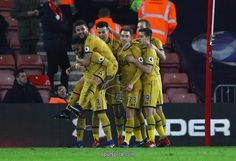 SOUTHAMPTON, ENGLAND - DECEMBER 28: Dele Alli of Tottenham Hotspur (20) celebrates with team mates as he scores their fourth goal during the Premier League match between Southampton and Tottenham Hotspur at St Mary's Stadium on December 28