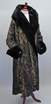 1920s gold lame brocade opera coat with fur collar and cuffs, lined in purple velvet