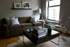 brown couch grey walls
