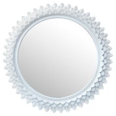 Perfect for your bedroom or bathroom, this wooden mirror features a sunburst petal design and a white finish.   Product: Mi...