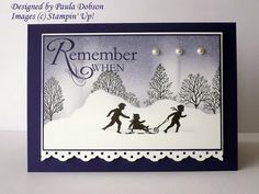 silhouette card...snow scene ... children with a sled...trees...