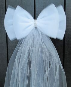 """White Tulle Bling Wedding Pew Bow. Beautiful with bling for home and wedding decor, parties, bridal and baby showers, centerpieces, and more! - Color: White - Size: 11"""" wide x 20"""" tails - Handcrafted"""