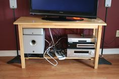Organize and hide your TV cords. I think this would work for under my desk, too. Hide Tv Cords, Hide Tv Cables, Hide Cable Box, Hiding Cords, Hidden Tv, Cord Organization, Organizing Ideas, Education Architecture, Wall Mounted Tv