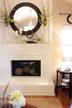 Love it! I like the simplicity of the mantle decorations. I would replace the mirror with a big clock tho