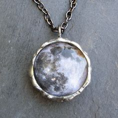 Stunning moon pendant showing both the near and far sides of the moon. Hand-soldered glass, on an antique style chain.