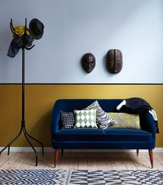 Blue velvet sofa - like the masks on the wall as well... and the color of the wall :)