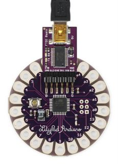 The LilyPad Arduino is a microcontroller board designed for wearable and e-textiles. It can be sewn to fabric and similarly mounted power supplies, sensors and actuators with conductive thread. The board is based on (the low-power version of Arduino Sensors, Arduino Programming, Arduino Led, Microcontroller Board, Conductive Thread, E Textiles, Arduino Board, Arduino Projects, Wearable Technology