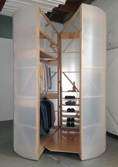 Tuberoom: Portable walk-in closet that hinges open: so many uses....shoe storage, books, baskets for accessories, handbags...the list goes on.