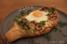 Kind of a khachapuri, kind of a flammkuchen, and definitely dill-y. It's got enough veg, protein and carbs to turn it into a decent dinner.