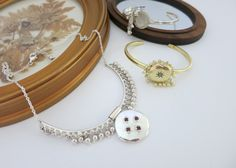 Victoria-ear inspired locket necklace in sterling silver with matching bracelets.