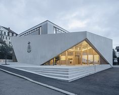 Completed in 2019 in Lausanne, Switzerland. Images by Matthieu Gafsou. The extension of Lausanne's New Apostolic Church was designed to draw out the existing building's intrinsic qualities. Architecture Durable, Church Architecture, Sustainable Architecture, Landscape Architecture, Architecture Design, Triangular Architecture, Sacred Architecture, Chinese Architecture, Futuristic Architecture