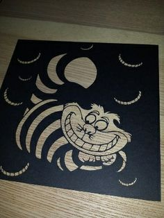 The Cheshire Cat from Alice in Wonderland papercut. Cut from a single piece of paper creating a beautiful piece of art