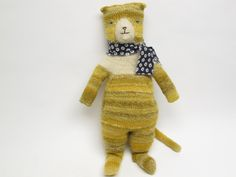 Popcorn The Cat, a hand knit cat doll. sold, via Etsy.