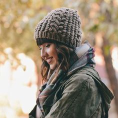A soft & cozy knit base adorns this darling beanie. Nubby knit mocha tones pair with a soft non-scratchy knit base for the perfect fall hat. Darling paired with your favorite sweater for chilly autumn