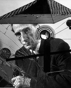 Another great photograph by Allan Grant: Marcel Duchamp with Dada artwork, 1953.