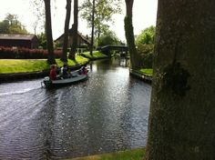 Giethoorn, a village in the Dutch province of Overijssel. Travel by boats in canals around the village.
