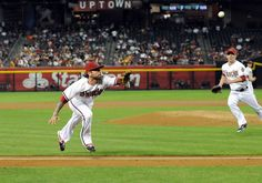 PHOENIX, AZ - APRIL 17: Ryan Roberts #13 of the Arizona Diamondbacks makes a play on a pop up against the Pittsburgh Pirates at Chase Field on April 17, 2012 in Phoenix, Arizona. Pittsburgh won 5-4. (Photo by Norm Hall/Getty Images)