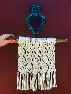 Handmade macramé wall hanging using 100% unbleached cotton and Santa Barbara driftwood . . Dimensions: 16 across, 19 in height from top of hanging string to bottom of fringe . . Arrives ready to hang . . Each piece that comes out of our shop is made in a kind, loving and clean