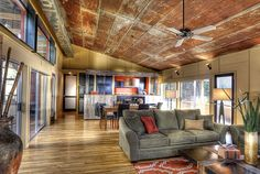 Salvaged metal ceiling panels make a unique addition to this industrial living room. Description from pinterest.com. I searched for this on bing.com/images