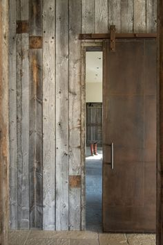 Rusted Steel Sliding barn door and old wood. #reclaimed #Steel #JLF