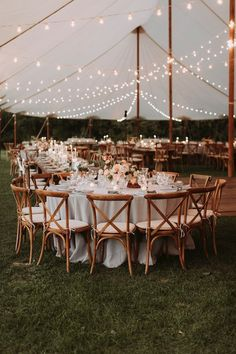 Fall tented wedding reception. Florals by Whimsy Weddings. www.whimsy-weddings.com. Photo by Salt Water Studios.