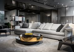 Collar seating system and Benson coffee table, Rodolfo Dordoni Design