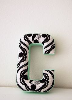 For a frame in our living room. Handmade Letter C by Forestgirldesign on Etsy, $16.00