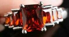 Size 7  Sterling Silver and Red Topaz $35.00.  815-529-2263