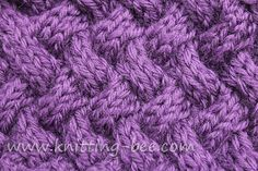 Medium sized diagonal basketweave cable knitting stitch pattern.
