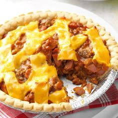 Hot Dog Pie Recipe -A co-worker who loves hot dogs shared this recipe with me. Baked in a purchased pastry shell, the pie is easy to assemble and is on the table in just 30 minutes. —Amy Bullis, Henryville, Pennsylvania