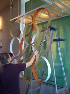 Make this using large embroidery hoops and some spray paint.- what about less hoops to use as accents in the 'circle design' room?