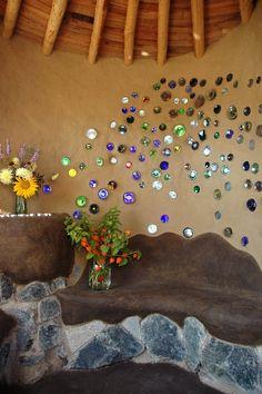 Glass bottle bottoms set into a wall