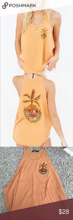 "Urban Outfitters Obey Island Tank Top NWOT Island-worthy tank top from OBEY. Long + relaxed fit featuring a raw-edge curved hem and cut-in armholes complete with a graphic at the chest and at the back finished with a banded crew-neck. Cotton. Machine wash. Made in USA Size + Fit. Model is 5'9"" and wearing a Medium. Color: orange. Size medium. Tag is cut to prevent store return. Obey Tops Tank Tops"