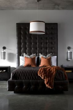 Sexy bedroom with black tufted leather headboard via Jennifer